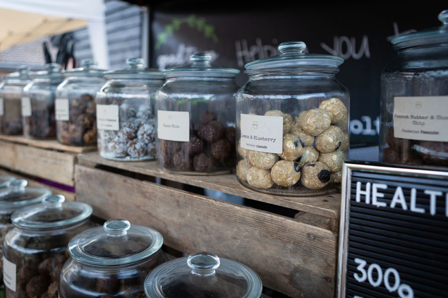 Food lifestyle photograph showing jars of protein balls