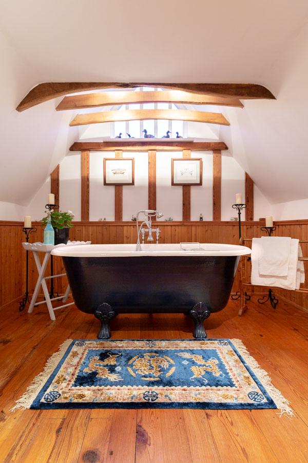 Interior Photogaph of a bathroom with roll top bath