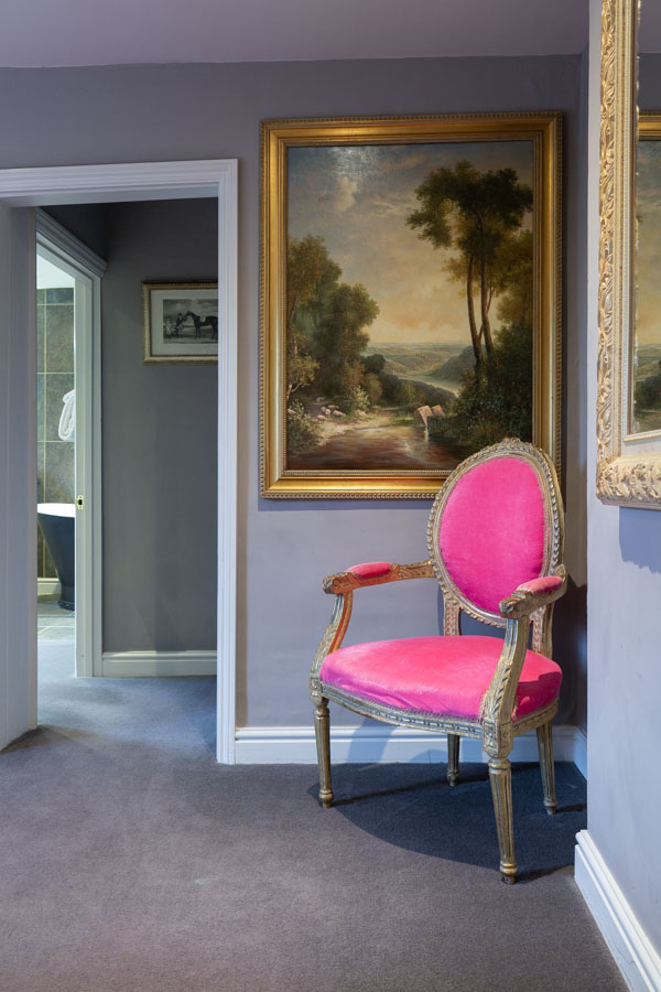 Pink chair in interior design photography showing rue of thirds